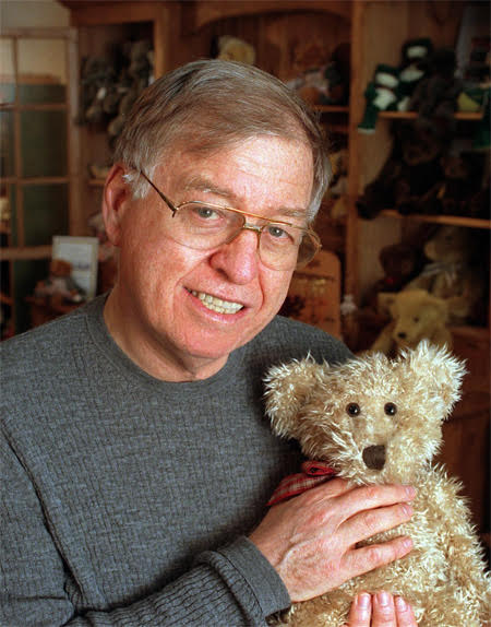 Russ Berrie Holing a Teddy Bear
