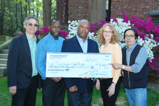 Haiti Scholarship Fund Committee member Shalom Gorewitz; Pierre Romain, founder of The Rose Foundation; committee members Ed Eloi, Lisa Lutter and Warner Wada. Each year The Rose Foundation donates $5,000 to the Haiti Scholarship Fund.