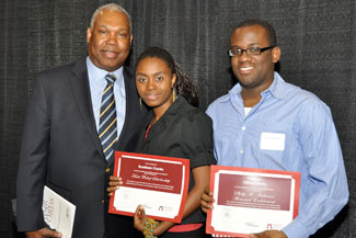 Ed Eloi, who serves on the Haiti Scholarship Fund Committee, with Roselaure Charles '15 and Clifford R. Denis '15 at the Ramapo College Foundation's Annual Scholarship Dinner that recognizes the academic efforts of all scholarship recipients.