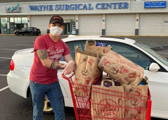 Joseph Giglio '22 with shopping cart full of Trader Joe's food bags